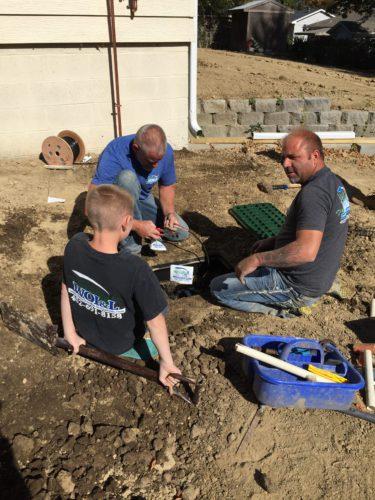 Family-owned West Omaha Irrigiation team installing a sprinkler system